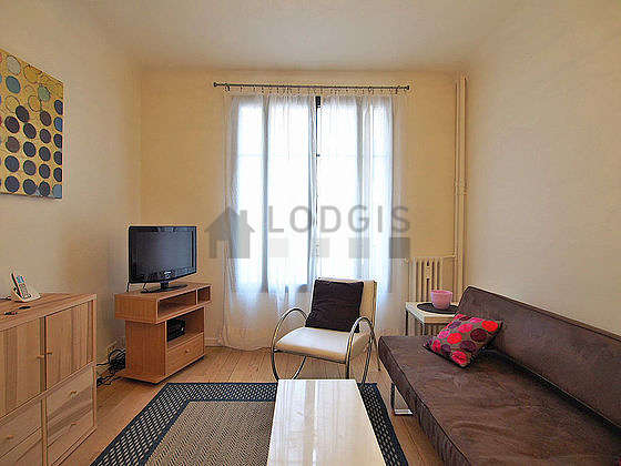 Quiet living room furnished with tv, 1 armchair(s), 2 chair(s)