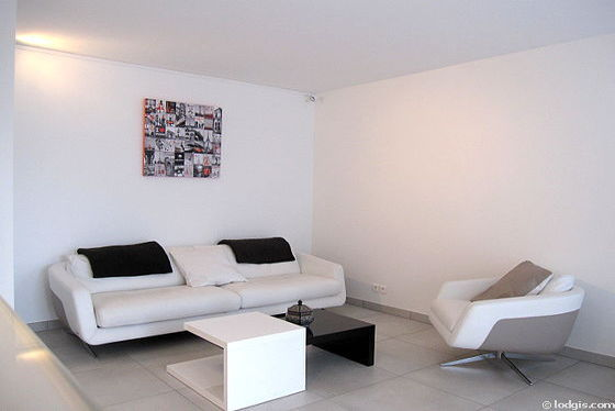 Very quiet living room furnished with tv, dvd player, 1 armchair(s), 2 chair(s)