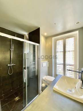 Bathroom equipped with washing machine, dryer, cupboard
