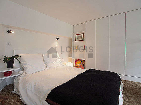 Very bright bedroom equipped with wardrobe, cupboard