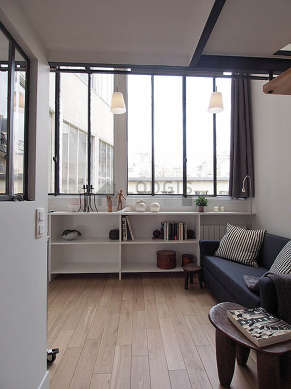 Living room with windows facing the courtyard