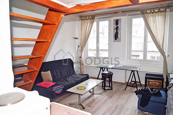 Quiet living room furnished with 1 sofabed(s) of 140cm, 1 loft bed(s) of 140cm, coffee table, wardrobe