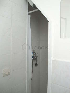 Bright bathroom with double-glazed windows and with tilefloor