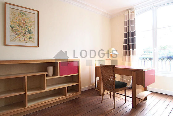 Quiet living room furnished with sofa, storage space, 3 chair(s)