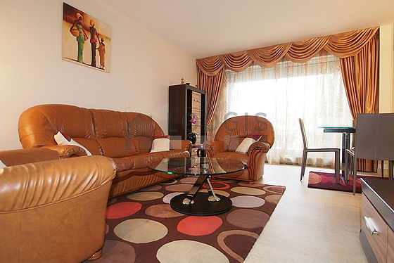 Very quiet living room furnished with tv, dvd player, wardrobe, 6 chair(s)