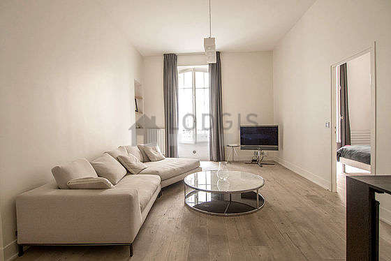 Very quiet living room furnished with tv, wardrobe, cupboard