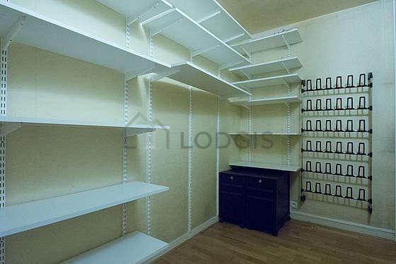Very quiet walk-in closet with woodenfloor