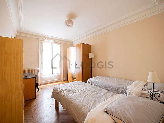 Chambre de 14m² avec du parquetau sol