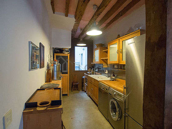 Kitchen equipped with washing machine, refrigerator, crockery, stool