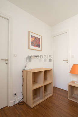 Bright bedroom equipped with bedside table
