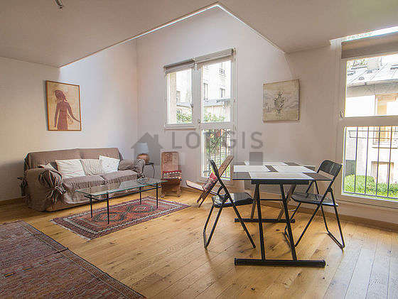 Very quiet living room furnished with sofa, 2 armchair(s), 4 chair(s)