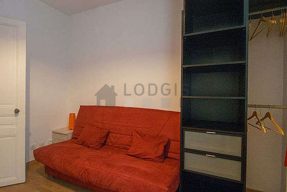 Quiet living room furnished with 1 sofabed(s) of 130cm, tv, wardrobe, cupboard