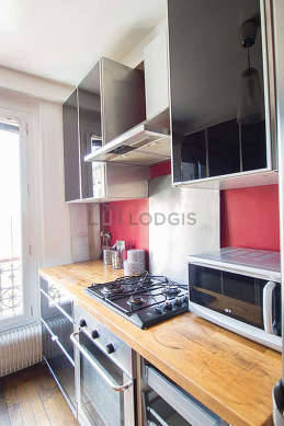 Bright kitchen with double-glazed windows facing the road