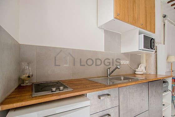 Kitchen equipped with dishwasher, hob, freezer, crockery