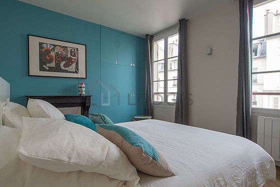 Bright bedroom equipped with wardrobe, cupboard, stool