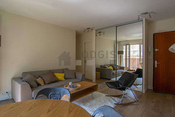 Living room with double-glazed windows and balcony facing the road