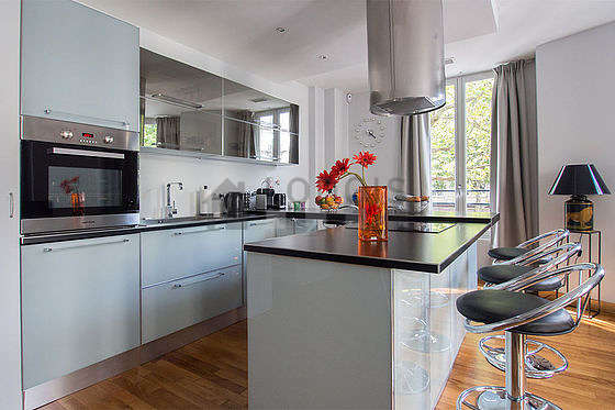 Very bright kitchen with windows facing the road