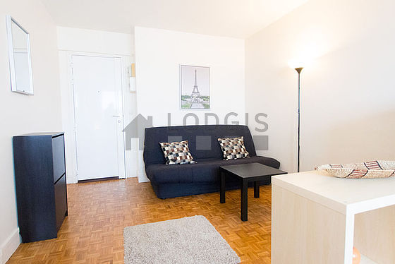 Very quiet living room furnished with 1 bed(s) of 140cm, 1 sofabed(s) of 140cm, tv, cupboard