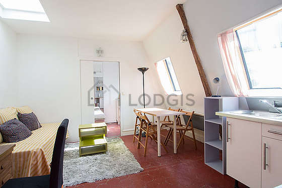 Very quiet living room furnished with 1 bed(s) of 90cm, 1 armchair(s), 4 chair(s)
