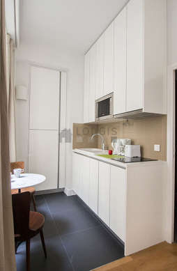 Kitchen where you can have dinner for 2 person(s) equipped with dryer, refrigerator, freezer, extractor hood