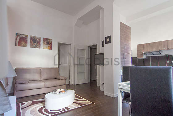 Living room furnished with tv, wardrobe, 4 chair(s)