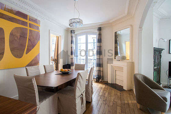 Dining room equipped with dining table, storage space