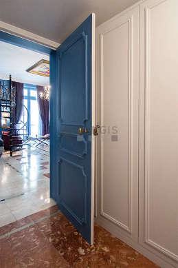 Walk-in closet with marblefloor
