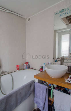 Pleasant and bright bathroom with double-glazed windows and with woodenfloor