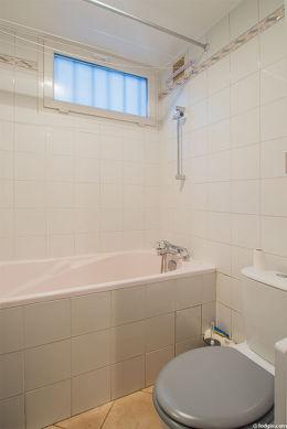 Beautiful bathroom with double-glazed windows and with tilefloor