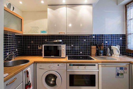 Beautiful kitchenopens on the dining room with tilefloor