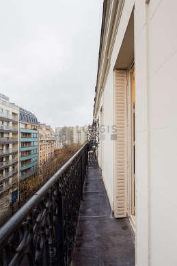 Balcony facing due south-east and view on road