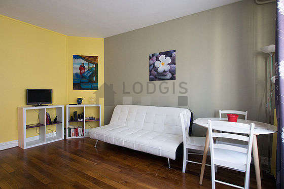 Very quiet living room furnished with tv, cupboard, 4 chair(s)