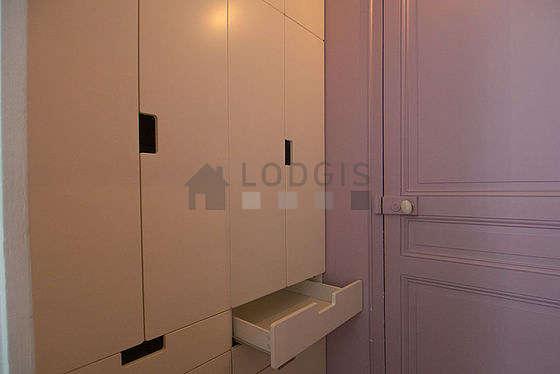 Quiet walk-in closet with woodenfloor