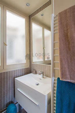 Beautiful bathroom with double-glazed windows and with tilefloor