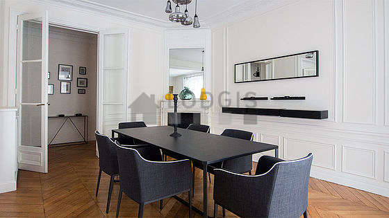 Dining room with windows facing the road