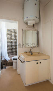 Bright bathroom with double-glazed windows and with linoleumfloor