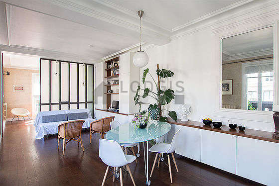 Living room with windows and balcony facing the road