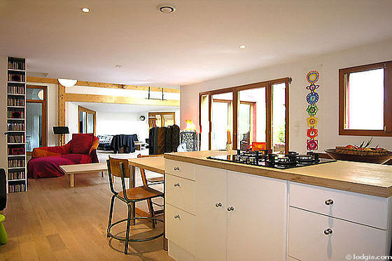 Very bright kitchen with double-glazed windows and balcony facing the garden