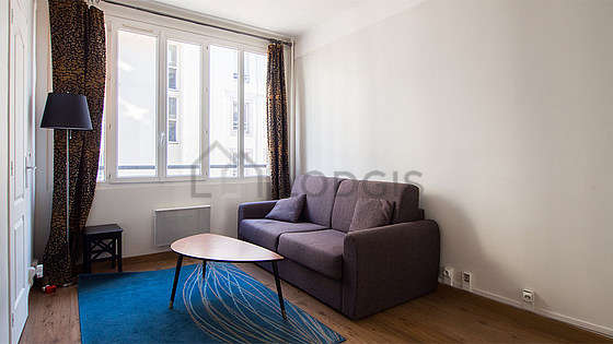 Living room furnished with 1 sofabed(s) of 140cm, coffee table, wardrobe