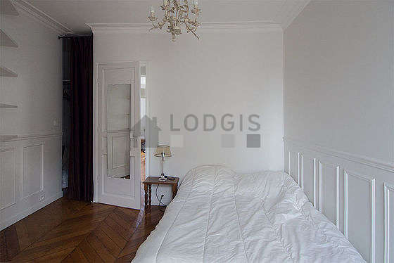 Bright bedroom equipped with tv, dvd player, bedside table