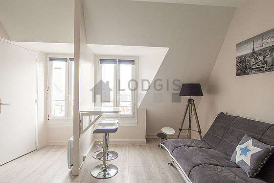 Very quiet living room furnished with 1 sofabed(s) of 120cm, tv, storage space, 1 chair(s)