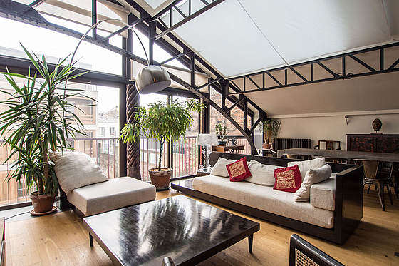 Living room with double-glazed windows facing the courtyard