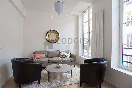 Quiet living room furnished with tv, dvd player, 1 armchair(s), 1 chair(s)