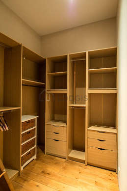 Quiet walk-in closet with woodenfloor