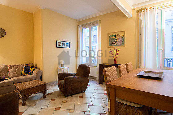 Quiet living room furnished with tv, dvd player, 6 chair(s)