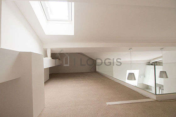 Mezzanine with a high ceiling with a carpetingfloor