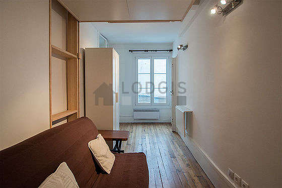 Very bright living room furnished with wardrobe, cupboard, 2 chair(s)