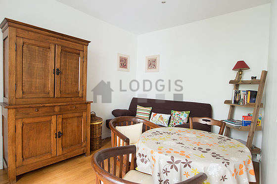 Very quiet living room furnished with 1 sofabed(s) of 140cm, dining table, closet, 3 chair(s)