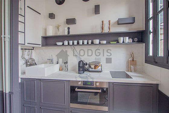 Magnifique cuisine de 0m²ouverte sur le séjour avec du carrelageau sol