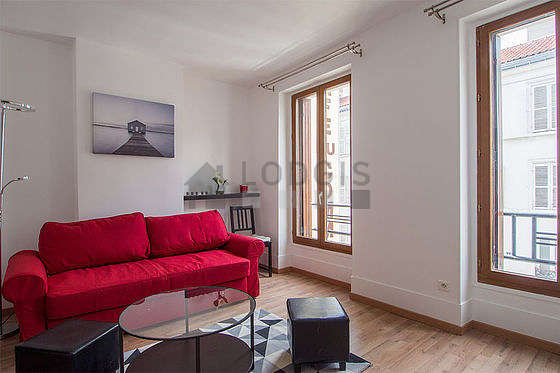 Quiet living room furnished with 1 sofabed(s) of 140cm, tv, cupboard, 1 chair(s)